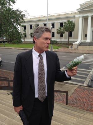 Eric Draper has been named state parks director. A leading conservationist in the state for decades, here he holds a bottle of St. Lucie River water containing blue-green algae at the Capitol during the 2016 session.
