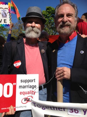 Robert J. Voorheis (left) and his partner, Yonkers City Councilman Michael R. Sabatino Jr., stood outside the Supreme Court Tuesday with other couples from across the country as the court heard arguments about gay marriage. Voorheis and Sabatino tied the knot in Canada and have been married 36 years.