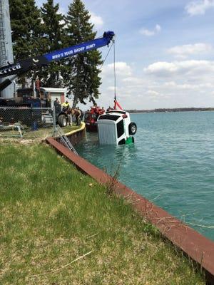 Rescue crews retrieve a Border Patrol SUV from the St. Clair River Wednesday, April 29, 2015.