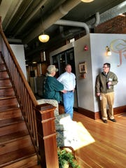 Scott Rubino, center, office manager of the Church, Harris, Johnson & Williams law firm, leads a recent tour showing how the firm has restored a 100-year-old building for its offices.