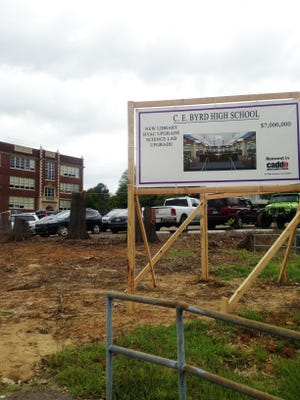 A sign outside of C.E. Byrd High School says how much the school will receive in upgrades if the Caddo Public Schools bond proposition passes.