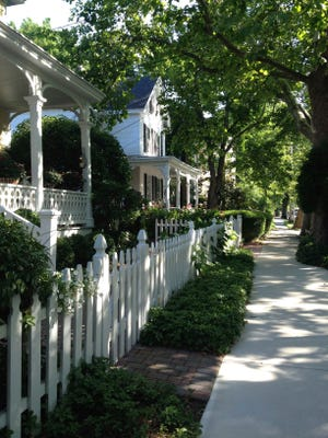 If you wander through the shady, laid-back town, you'll quickly notice that the colorful Victorian homes are adorned with elaborate gardens, eccentric details and people casually enjoying their tea on wrap-around porches.