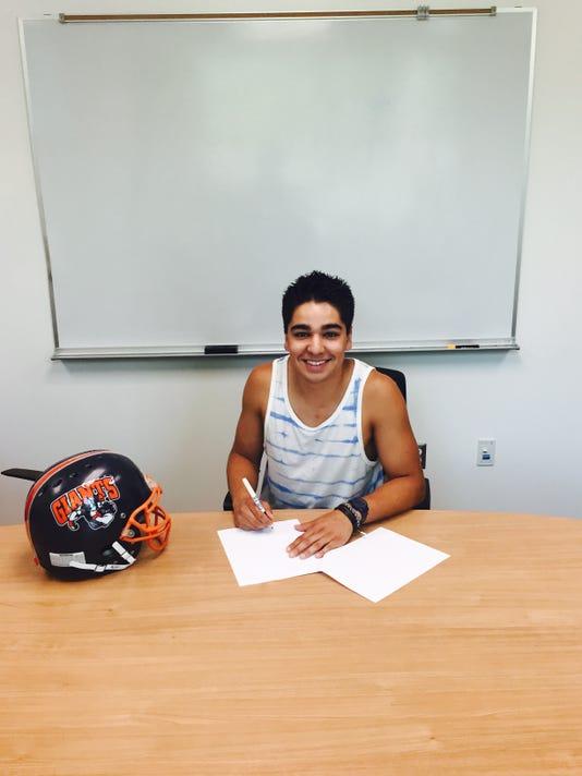 Raul signing.jpg