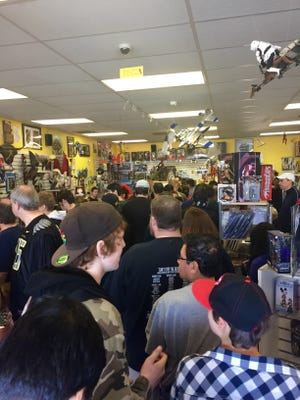 Comic book fans stand in line to check out the nearly 2,000 free comic books that were available in honor of Free Comic Book day on Saturday, May 2, at Tony's Kingdom of Comic & Collectibles.