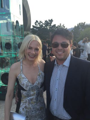 David Parker, co-owner of The Body Deli, is pictured with Michelle Williams at the Louis Vuitton fashion show on May 6, 2015 at the Bob Hope home.