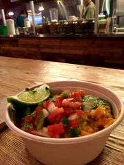 Five on Black in Missoula serves bowls filled with rice, meat, black beans, sweet potatoes and toppings.