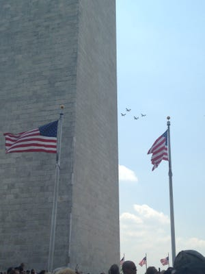 Vintage WWII planes fly past the Washington Monument Friday during a historic flyover commemorating the 70th anniversary of Victory in Europe Day.