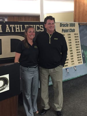 Delphi athletic director Kevin Sims, right, introduced Rainey Jones as the Oracles girls basketball coach on Tuesday.