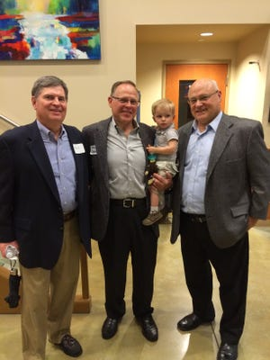 Rebuilding Together Oakland County President Gale Frazee, left, Commission on Children, Youth and Families adult award winner Jack Schertel with grandson Vincent, 21 months, and RTOC Executive Director Al Kaczkowski pose for a photo prior to the volunteer awards ceremony.