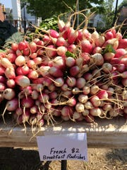 Locally grown fruits and vegetables draw people in to the Farmington Farmers Market.