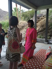 """Fashion designer Trina Turk chats with a guest during a brunch she hosted at her iconic """"Ship of the Desert"""" home Friday to celebrate her 20th anniversary."""