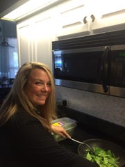 Kristi Renfroe gets cooking in the kitchen.