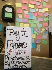 "On each Monday and Saturday, the eatery sells slices of pizza for $1, and the funds raised from ""Pay It Forward"" go to local charities."