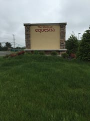 Sign for the impending Shops at Equestra.