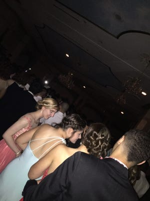Winslow Township High Schoolers huddle on the dance floor at The Mansion on Main Street in Voorhees during a power failure that shut their prom down early on May 15.