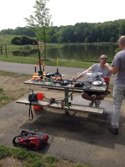 Members of the Rotor-E Drones Club discuss the modifications they made to their drones