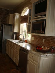 The kitchen in the home boasts slab granite and top of the line appliances.