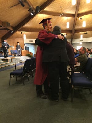 Senior Lucas Edward Deitrick hugs his parents, Edward and Loralee Deitrick, after receiving his diploma at Faith Christian School on Saturday.