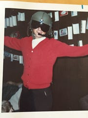 This photograph of Gerald Woods, wearing an aviation helmet as a youngster, is among the favorite snapshots Yvonne Sanders has of her brother, a helicopter pilot who was killed during the Vietnam War.