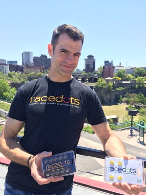Pittsford native Jason Berry created RaceDots, which are heavy duty magnets that hold an athlete's race bib in place. The product uses materials from two Rochester-based businesses.