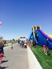 Kids slid down the tallest inflatable water slide in the world Saturday.