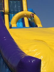 The water slide sent kids flying in the air, then safely landing on a tarp.