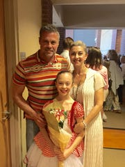 Troy Gentry, Kaylee Gentry and Angie Gentry attend Kaylee's dance recital this year.