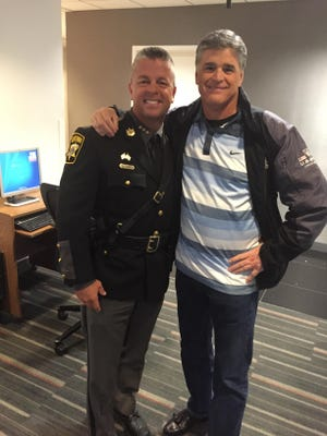 Wicomico County Sheriff Mike Lewis is shown with Fox News media personality Sean Hannity.