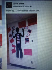 A display at Clearview Regional High School raised eyebrows for its depiction of a black silhouette with its hands up.