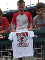 Sheldon Johnson displaying Yutan High School shirt