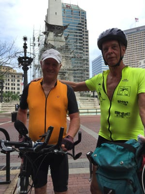 """David Campbell, 73, (left) and Kevin Enright, 65, take a break in Indianapolis midway through their 275-mile bicycle trip from north to south across Indiana. The Bloomington men left Hammond on Saturday and will finish their ride in Clarksville. """"It is a great way to see Indiana,"""" Enright says. """"There is just a lot of character in these little Indiana towns. A real treasure."""""""