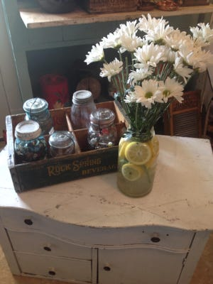 These daisies are displayed in a vintage Mason jar from the early 1900s. BuyGones Antiques and Collectibles in Sauk Rapids carries a variety of similar vintage jars from Kerr, Ball, Globe, Atlas, McDonald and Mason.