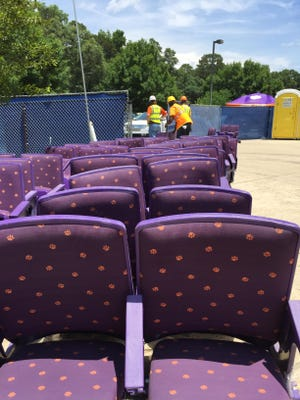 Old seats from Littlejohn Coliseum are prepped to be loaded Friday during a public pick-up outside the arena.