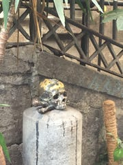 A replica of a skull sits outside Santa Maria delle Anime del Purgatorio ad Arco -- a church. You rub the skull's head to bring luck and to help souls escape Purgatory.