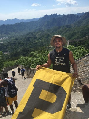 Sophomore guard PJ Thompson poses with a Purdue flag atop the Great Wall of China. Thompson played exhibition games in China with the USA Eagles program in earlier this spring.
