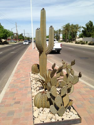 Chandler is installing 70 cacti made of steel, along with brick pavers, boulders and decomposed granite, as part of a median upgrade project.