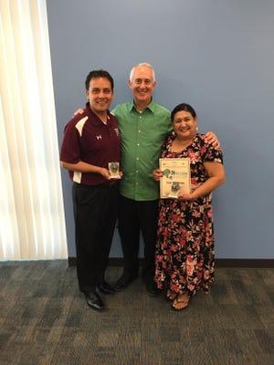 SARB/SAP Coordinator Don Slusser presents the district's Bulldog Award to Rancho Mirage Middle School Assistant Principal Julio Omier and district community liaison Susan Cabeje.