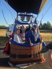 From left, Marlene Luchau and her husband Clark Luchau, Jim Desch and John Luchau (behind) get ready to go up on the hot air balloon.