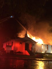 Tallahassee Fire Department firefighters work to extinguish a fire at Greater Miracle Apostolic Holiness Church Friday.