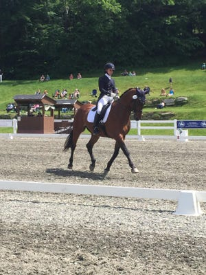 Ontario grad Emily Wright with her horse Florestano in a dressage competition.