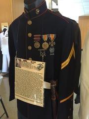 The oldest uniform on display belonged to Marine Cpl.