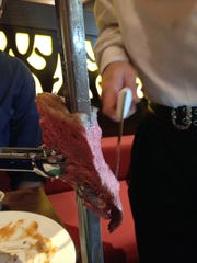 Gauchos, or Brazilian cowboys, serve cuts of meat at your table at Rodizio Grill.
