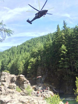 Salem Fire Technical Rescue Team and the Army Air National Guard extract a man who jumped off rocks at Three Pools.