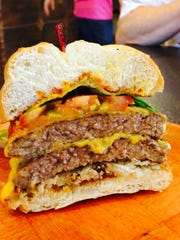 The double cheeseburger at One Hot Grill has two-thirds a pound of beef atop an egg bun.
