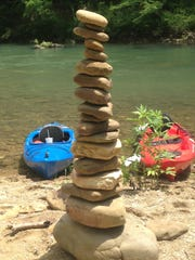 A tall stack of river rocks carefully placed by Buffalo