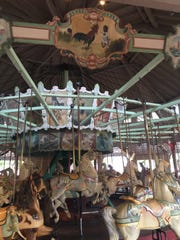 The panel showing racial caricatures is one of 18 atop the Dentzel carousel at Ontario Beach Park.