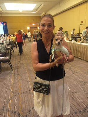 Patt Savastano attended the Pets on Parade luncheon with her chihuahua Angelo on Saturday.