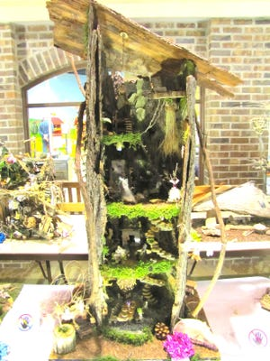 The Corn Hill Neighbors Association selected the winners of the Third Annual Fairy Houses Tour, which took place at the 2015 Corn Hill Arts Festival. This year's winner is the Marshall Family for their intricately designed house.