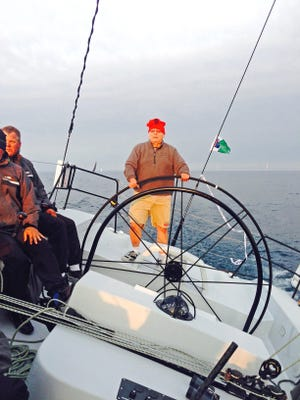 Skipper Peter Reichelsdorfer steers across the finish line of the 2015 Chicago Yacht Race to Mackinac for the 50th time, earning him the title of Master Mariner.