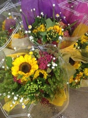 Summer bouquets, grown and arranged at Durr Farms in Chesterfield, await transport to area Whole Foods.